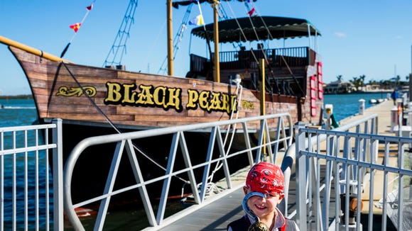 Gavin Montgomery, 4, smiles as he patiently waits in his pirate attire to board the Black Pearl on Saturday, Dec. 2, 2017 in Marco Island.