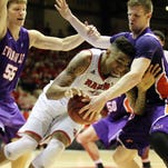 UL's Shawn Long (21) is double teamed by the University of Evansville's Egidijus Mockevicius (55) and Adam Wing (12) in a CIT basketball tournament game Thursday at Blackham Coliseum in Lafayette.