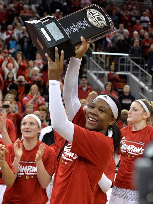 Louisville forward Myisha Hines-Allen (2) holds up the ACC Conference trophy following their 81-49 victory over Pittsburgh, Sunday, Feb. 25, 2018, in Louisville, Ky. Hines-Allen, the lone senior on the team finished the game with 18 points and 16 rebounds. (AP Photo/Timothy D. Easley)