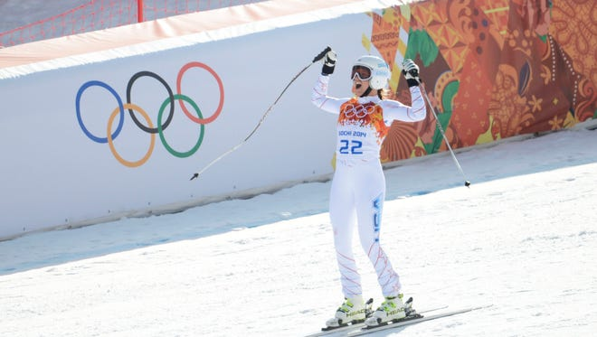 Julia Mancuso of the USA sees her time as she hits the finish line in the downhill portion of the super combined.