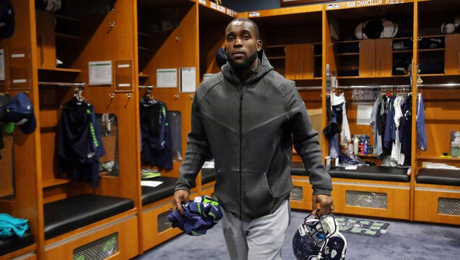 Seahawks safety Kam Chancellor walks through the locker room as players clean out their lockers Sunday at the Virginia Mason Athletic Center in Renton.
