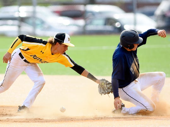 Red Lion's Cole Daugherty, left, looks to catch the