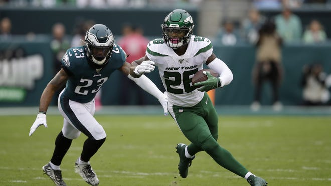 This Oct. 6, 2019, file photo shows New York Jets running back Le'Veon Bell, right, rushing past Philadelphia's Rodney McLeod. The New York Jets have surprisingly released Bell, ending a disappointing tenure after less than two full seasons.