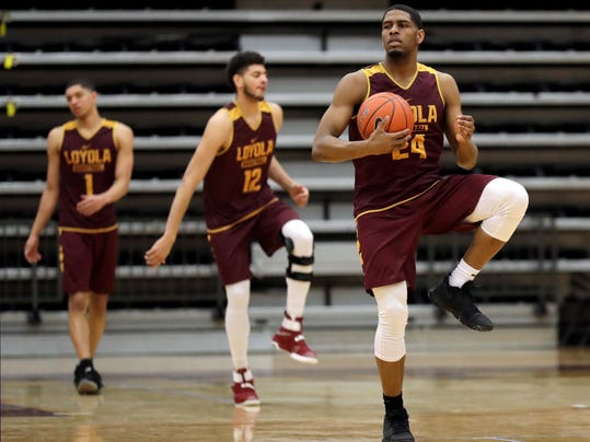 Loyola forward Aundre Jackson, right, warms up with teammates during NCAA college basketball practice in Chicago, Friday, March 9, 2018. Loyola locks up 1st March Madness appearance in 33 years. (AP Photo/Nam Y. Huh)