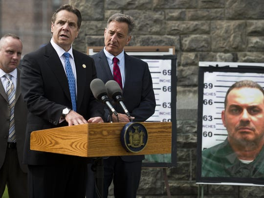 New York Gov. Andrew Cuomo speaks during a news conference outside the Clinton Correctional Facility in Dannemora, New York, on June 10. A photo of escaped killer Richard Matt is at far right. Matt was later shot and killed by authorities.