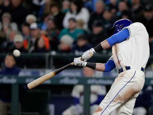 Seattle Mariners' Mitch Haniger hits a two-run home run against the Cleveland Indians during the seventh inning of a baseball game Sunday, April 1, 2018, in Seattle. (AP Photo/Ted S. Warren)