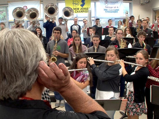 Jackson Memorial High School's iconic band director Bud McCormick listens to his band Wednesday.