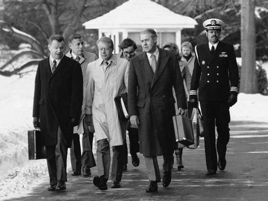 FILE - In this Feb. 14, 1979 file photo, President Jimmy Carter, flanked by Secretary of State Cyrus Vance, right, and his adviser on foreign policy, Zbigniew Brzezinski, left, walk toward a waiting helicopter to fly to the nearby Andrews Air Force Base, Md. Brzezinski, the national security adviser to President Carter, died on Friday, May 26, 2017, at age 89. His death was announced on social media by his daughter, MSNBC host Mika Brzezinski.