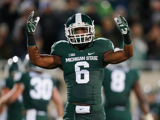 Mylan Hicks is pictured playing for Michigan State in a game against Nebraska in 2014.