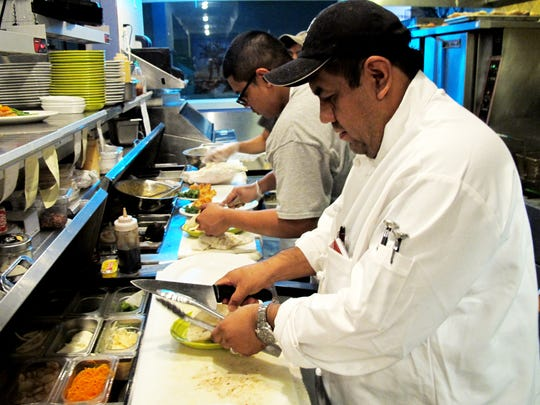 Executive Chef Hector Hidalgo, shown at work in November 2015 in the kitchen of Fish Crazy Restaurant in North Naples, will be back next month as the chef at a new local restaurant, Randy's Coastal Kitchen.