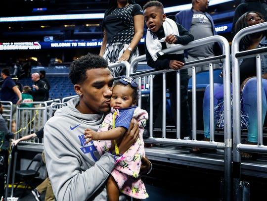 Memphis injured guard Jeremiah Martin (left) kiss his