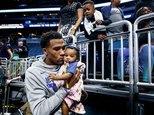 Memphis injured guard Jeremiah Martin (left) kiss his daughter Journee after the Tigers defeated USF 79-77 in their AAC first round tournament game in Orlando, Fl., Thursday, March 8, 2018.