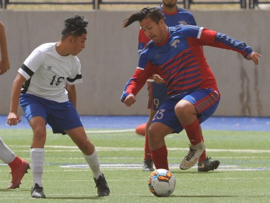 Cooper's Isiah Arratia, right, plays the ball as El Paso Bowie's Fernando Ortiz defends during their Region I-5A area playoff game April 3, 2018, at Midland Grande Stadium.