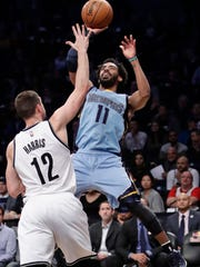 Memphis Grizzlies' Mike Conley (11) shoots over Brooklyn Nets' Joe Harris (12) during the first half  Monday in New York.