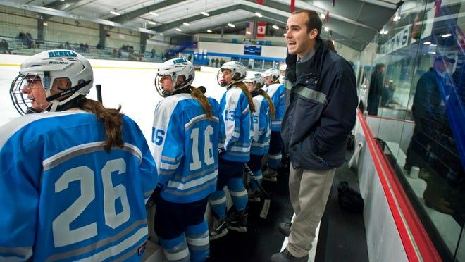 South Burlington girls hockey coach Jake Orr directs his team against Rice Memorial in South Burlington on Thursday, December 11, 2014.