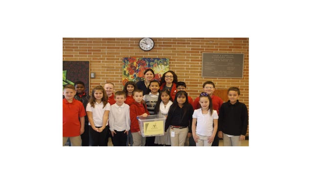 Denise Diorio and the students in the Adopt-a-Soldier Club at D'Ippolito Elementary School presented Sonia Mixter Guzman with can-tab donations, which will be used to help raise funds for the Ronald McDonald House of Southern New Jersey. Thousands of tabs were collected by students, staff and their families. The collection will continue throughout the school year.