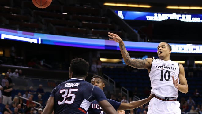 Cincinnati Bearcats guard Troy Caupain (10) passes the ball in the third overtime against the Connecticut Huskies during the AAC Tournament at the Amway Center. The Connecticut Huskies won 104-97.