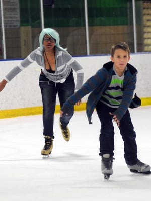 Trevor Smith,12, and Kelsi Crutchfield,13, show off their speed on the ice.