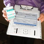 Woman holding clipboard with drug test
