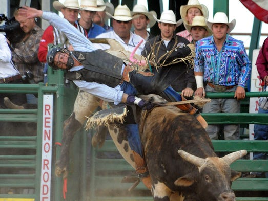 Clayton Foltyn of Winnie, Texas, competes in the Reno Xtreme Bulls event Thursday, June 19, 2014, at the Reno Livestock Events Center.