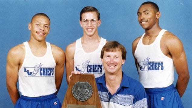 Former Lake View High School track and field coach Nat Sawyer is shown with his state-title winning 1993 team. The athletes (from left) are Jerome Bryant, Jeff Lewis and Terrence Norris.