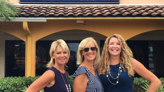 Martin County Women's Council of Relators, including  Cheryl Nevius (from left), Ellen Snow and Nicole Mier, is getting ready to host their annual Purse Auction.