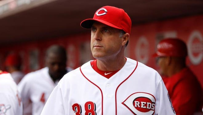 Reds manager Bryan Price (38) looks on as his team plays against the St. Louis Cardinals for their Opening Day game at Great American Ball Park.