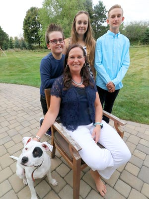 Corinne Merton and children Brayden, 10, Grace, 14, Jacob, 13, and pet Ollie at their Hartland home. All of the Merton children are living with Type 1 Diabetes.