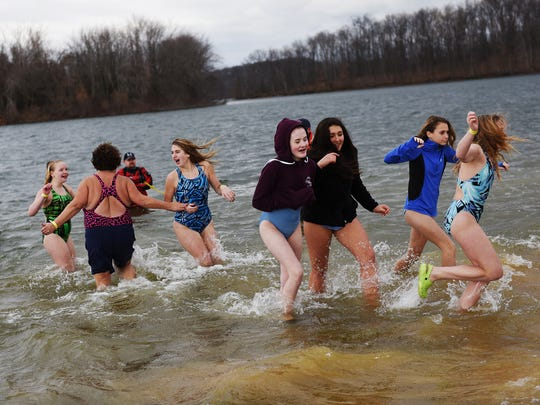 A group braves the cold waters of Lake Marburg during the Eagle Plunge at Codorus State Park on Saturday Jan. 16, 2016 during the Codorus State Park Winter Festival.