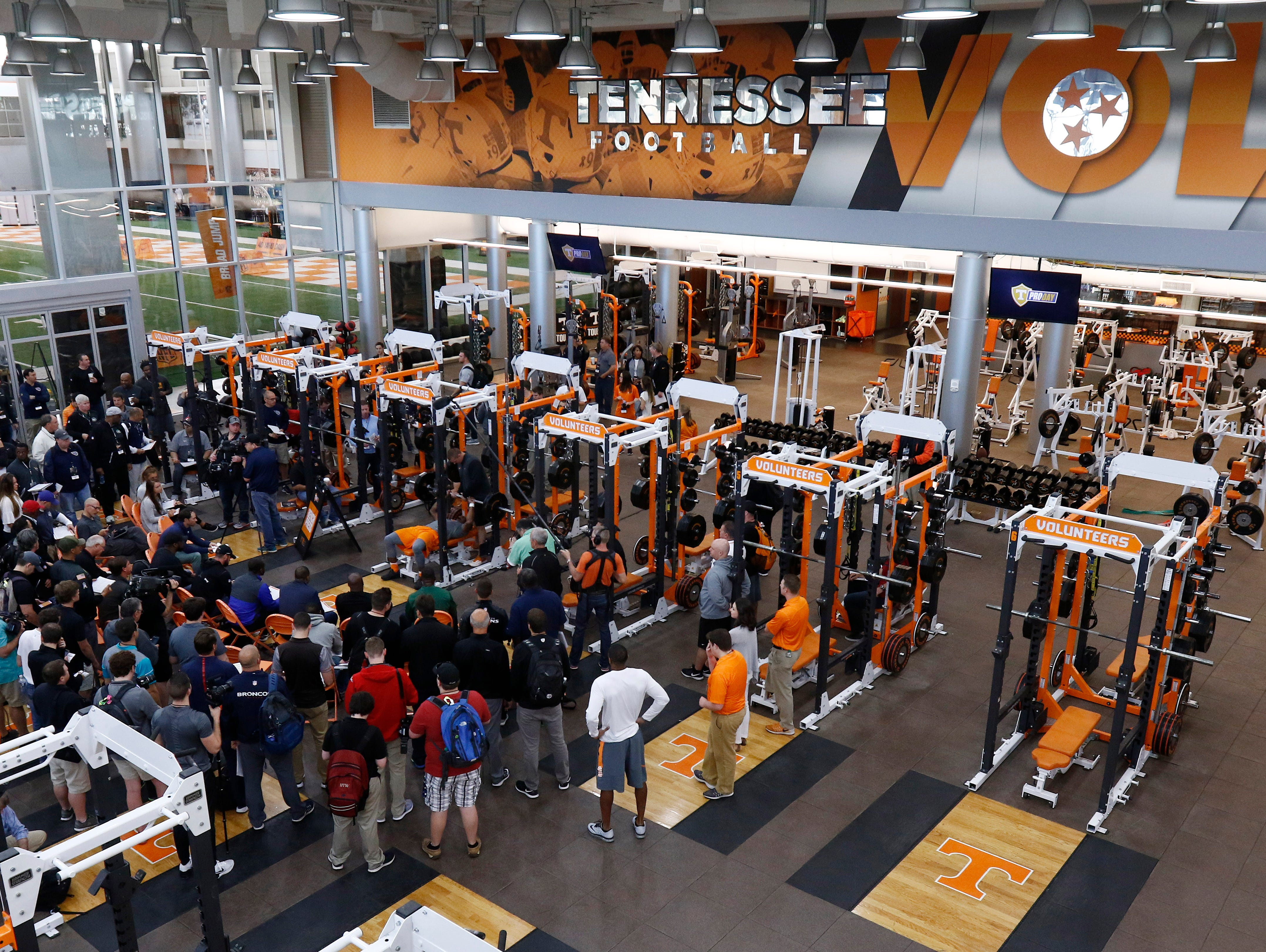 NFL scouts and media watch as a player bench presses during the NFL Pro Day at UT Friday, March 31, 2017 in Knoxville, Tenn.