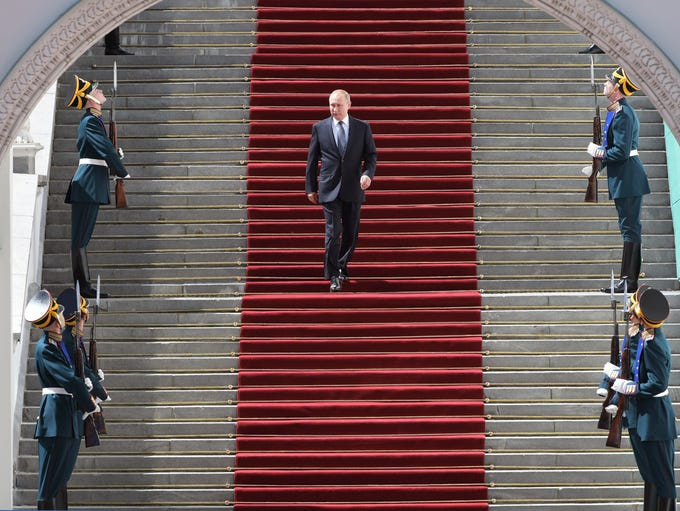Vladimir Putin walks after his inauguration ceremony