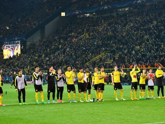 Dortmund players acknowledge the supporters after losing 2-3 during the Champions League quarterfinal first leg soccer match between Borussia Dortmund and AS Monaco in Dortmund, Germany, Wednesday, April 12, 2017. (AP Photo/Martin Meissner)