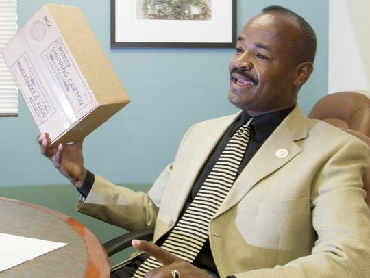 In this 2005 photograph, Don Logan, Scottsdale Director of Diversity and Dialogue, talks about the bomb explosion in 2004 that rocked his office and the city of Scottsdale. The bomb was mailed to Logan in a box like the one he is holding.