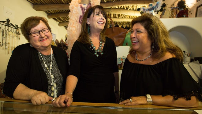 Donna Rosati, center, owner of My Rich Sister's Closet & Boutique, shares a laugh with Vintage Sales Associate Teresa Sutton, left, and Sales Associate Alice Snyder, at the Mesilla shop Monday, Aug. 8, 2016.