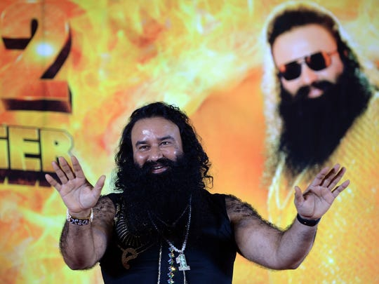 This file photo taken on Sept. 8, 2015 shows Indian chief of the religious sect Dera Sacha Sauda (DSS) Gurmeet Ram Rahim Singh at a news conference to launch the score for his film 'MSG-2 The Messenger' in Mumbai.