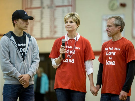 Lana Wagner speaks with her son Brett and husband Gregg at her side during the annual Big Reds Believe students vs. staff charity basketball game Friday, March 24, 2017 at Port Huron High School. The 2018 Big Reds Believe Game will support Port Huron High School class of 2006 graduates Kenneth and Ashley Robinson and their son Preston.