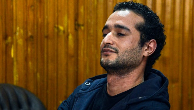Ahmed Douma, one of the leading activists behind Egypt's 2011 uprising, attends a court hearing in a case against 230 people including Douma, for taking part in clashes between protesters and security forces, in a courtroom of Torah prison, Cairo, Egypt, Wednesday, Feb. 4, 2015.