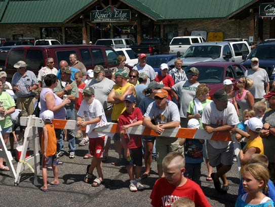 The crowd at last years Take an Adult Fishing Tournament.
