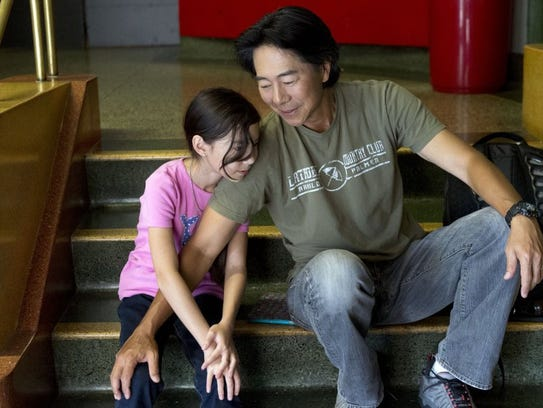 "Henry Cho with his daughter, Tate, on the set of ""Saving"