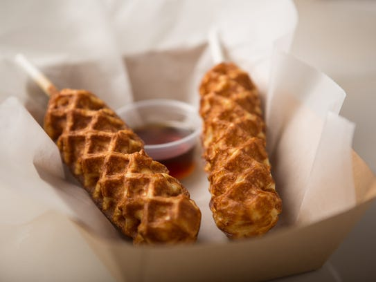 """The """"concept dog"""" chicken and waffles on a stick from"""