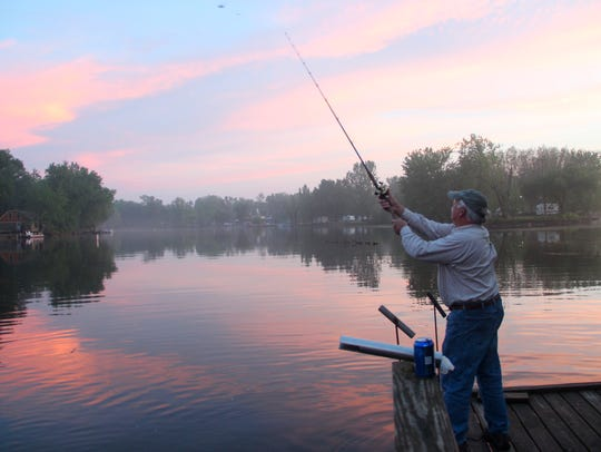 Tom O'Day of Weywauwega casts while fishing for flathead catfish on the Wolf River near Gill's Landing.