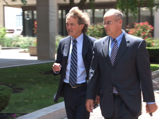 Peter W. Hayes (right) walks into the federal courthouse last year with his attorney Eugene Maurer Jr.