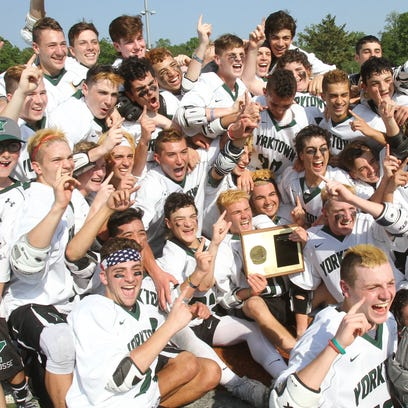 Yorktown players celebrate with the Section 1 plaque