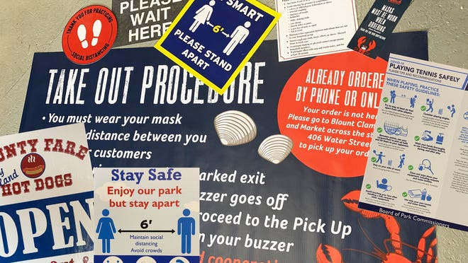 A collection of pandemic-related products custom-made by Baker Sign Works.