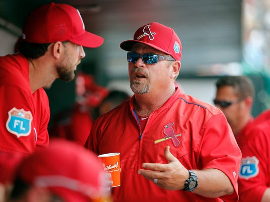 FILE - In this March 18, 2016, file photo, St. Louis Cardinals', left, Adam Wainwright, talks with the pitching coach Derek Lilliquist in the dugout, during the fifth inning of a spring training baseball game against the Detroit Tigers in Jupiter, Fla. Former major league skipper Chip Hale will be the bench coach for new Washington Nationals manager Dave Martinez, while Derek Lilliquist will be the team's pitching coach, the Nationals announced, Thursday, Nov. 9, 2017. Lilliquist was the St. Louis Cardinals' pitching coach for the past six seasons. (AP Photo/Brynn Anderson, File)