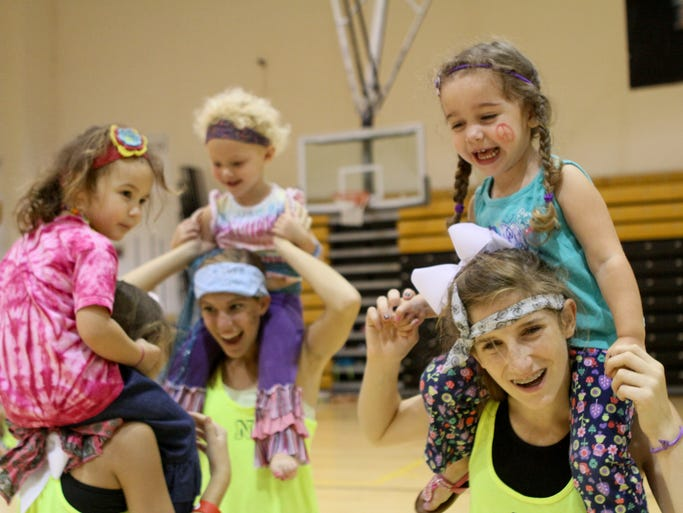 More than 90 girls from three-years-old and up attend the Neville High School Cheer Clinic. Neville cheerleaders have hosted the camp for more than 30 years. Each day of the clinic has a theme and on Thursday the girls dressed like hippies.