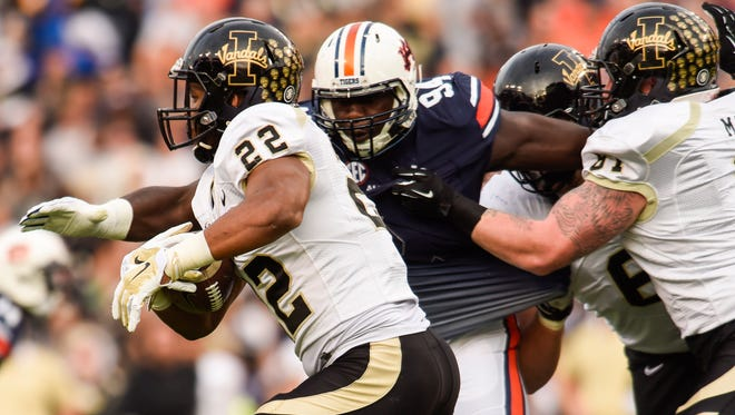Auburn defensive lineman Devaroe Jamal Lawrence (94), a Carolina High grad, had a solid junior season, capped by his being named ESPN Player of the Game in the Birmingham Bowl.