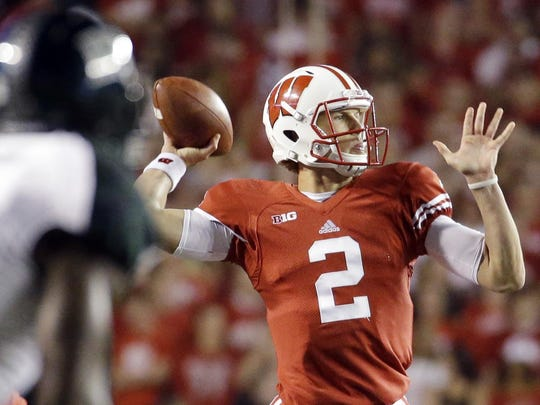 Wisconsin quarterback Joel Stave drops back to pass during the first half of an NCAA college football game against Hawaii Saturday in Madison.
