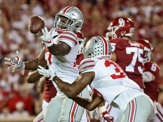 Ohio State linebacker Jerome Baker catches a deflected pass and returns it 68 yards for a touchdown in Saturday's 45-24 win over Oklahoma.