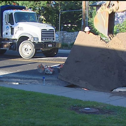 A crew works to repair a section of Holly Street in Nampa after flooding caused a sinkhole to form Sunday, August 31.